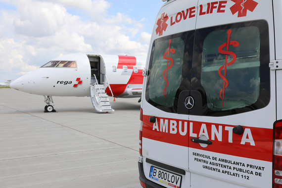 Ground ambulance in front of Swiss Air-Ambulance jet